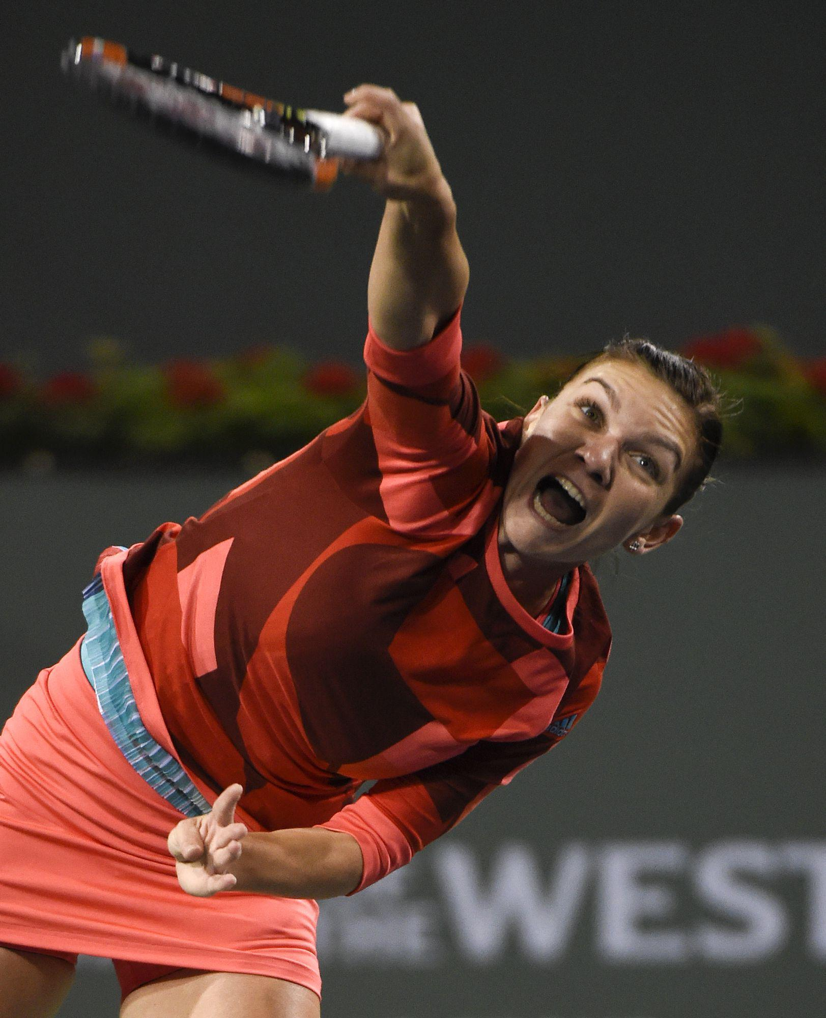 epa05207160 Simona Halep of Romania in action against the Vania King of the USA during their second round match at the BNP Paribas Open in Indian Wells, California, USA, 11 March 2016.  EPA/RAY ACEVEDO