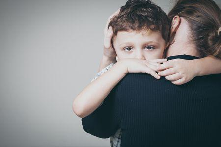 49451380 - sad son hugging his mother at home. concept of couple family is in sorrow.