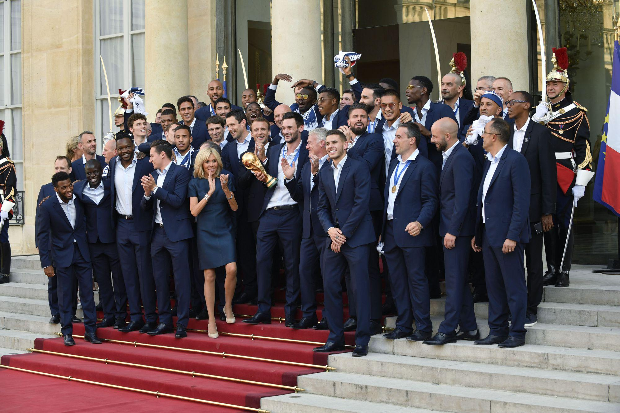 epa06893544 French President Emmanuel Macron and French First Lady Brigitte Macron with the France's national soccer team players at the Elysee Palace, in Paris, 16 July 2018. France won 4-2 the FIFA World Cup 2018 final against Croatia in Moscow, on 15 July.  EPA-EFE/JULIEN DE ROSA
