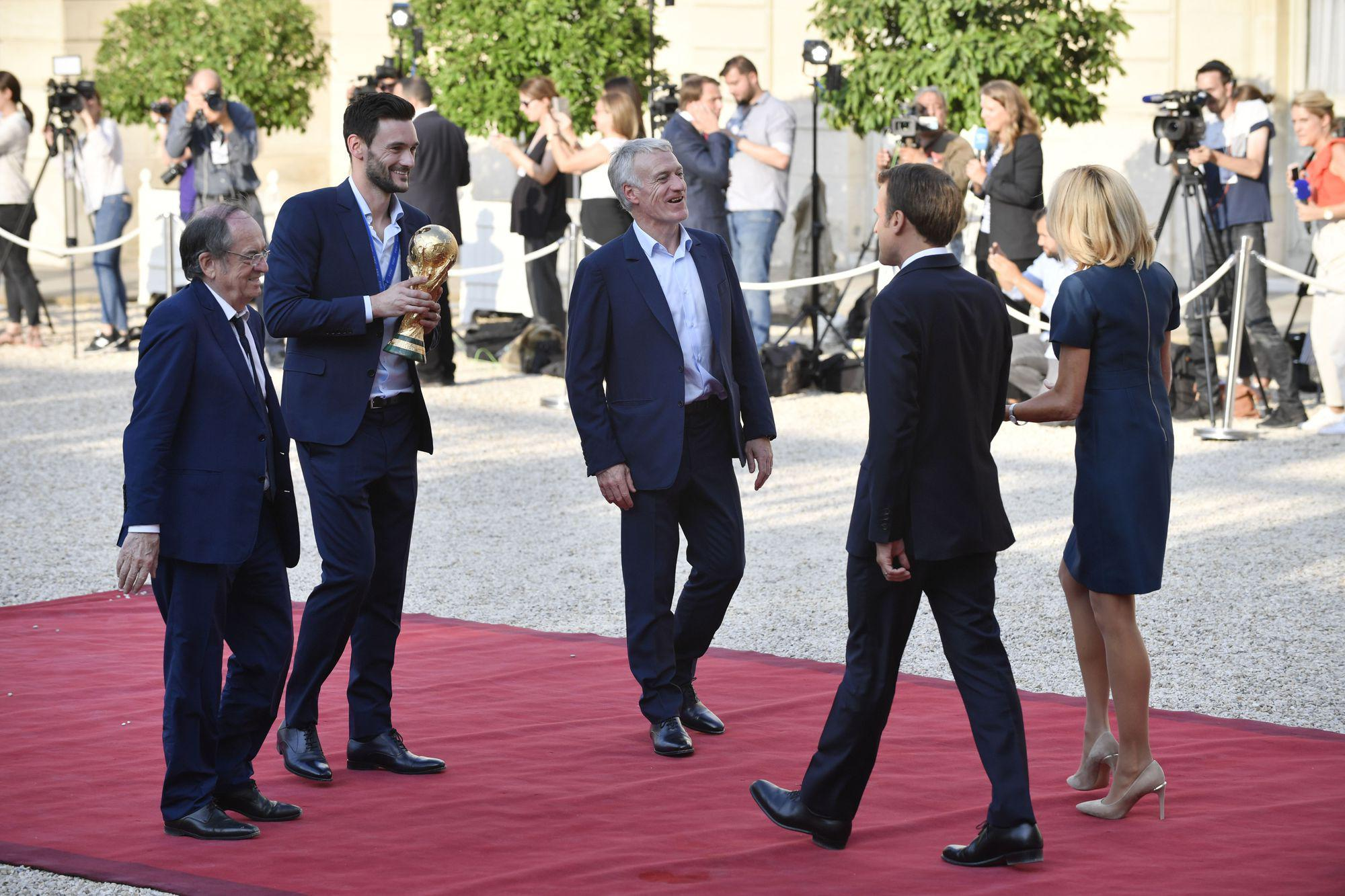 epa06893553 French President Emmanuel Macron and French First Lady Brigitte Macron welcomes the France's national soccer team at the Elysee Palace, in Paris, 16 July 2018. France won 4-2 the FIFA World Cup 2018 final against Croatia in Moscow, on 15 July.  EPA-EFE/JULIEN DE ROSA