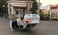 Un polițist băut aflat în misiune s-a răsturnat cu mașina după un accident