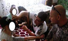 FOTO/ Fetița împușcată accidental de un polițist în Maramureș, îngrijită de oamenii legii până la sosirea ambulanței