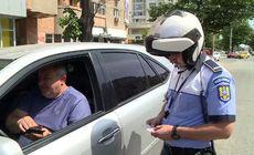 Reacția uimitoare a unui șofer prins că vorbea la telefon în trafic