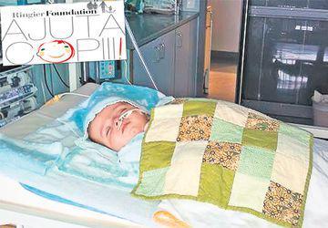 Cristian Oprea, de şase luni, trebuie operat în SUA, ca să nu rămână orb