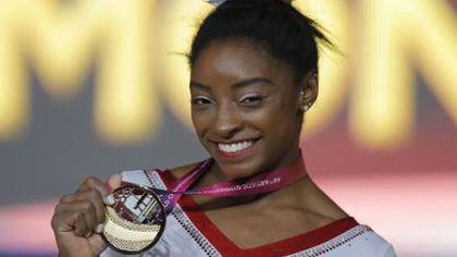 Simone Biles, 13 medalii de aur la Mondiale și 4 medalii de aur la JO. L-a depășit pe bielorusul Vitaly Scherbo